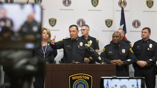 Houston officer shot after 4 suspects beat priest; 1 sought