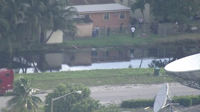 Police search Miami Gardens canal after report of body in water