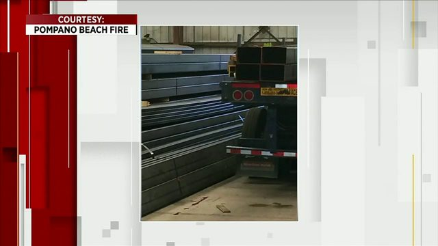 Load of steel crushes truck driver at Pompano Beach business