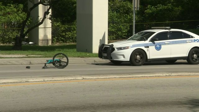 Bicyclist stable after being struck by Miami police car