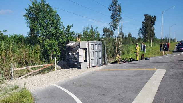 Driver airlifted to hospital after dump truck overturns on Krome Avenue