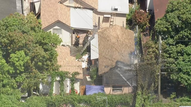 Fire destroys efficiency behind home in Hialeah