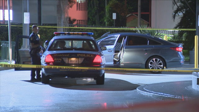 Police investigate after car shot at with several people inside