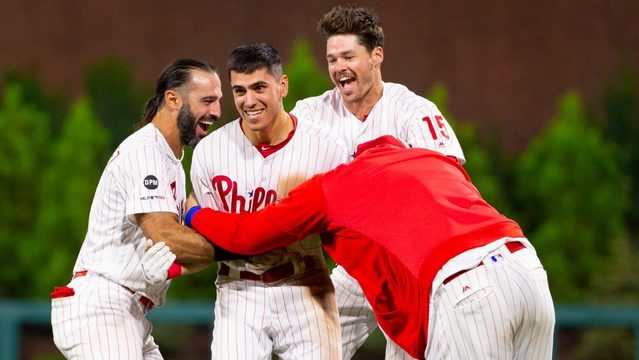 Phillies hold on to beat Marlins in 15 innings
