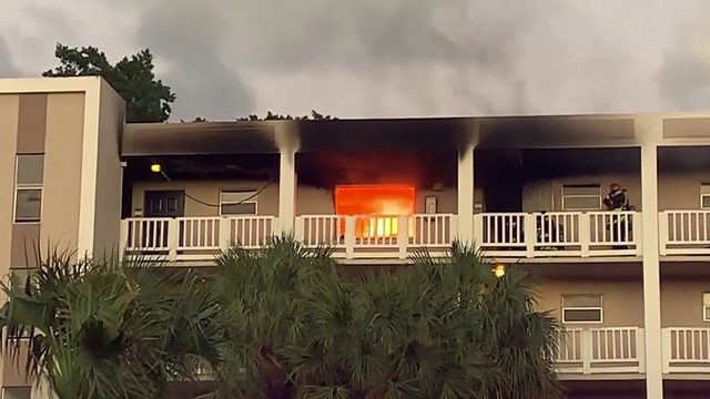 Unit on top floor of apartment building engulfed in flames in Coral Springs