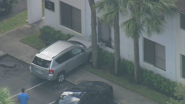 SUV strikes wall of apartment building in Coral Springs