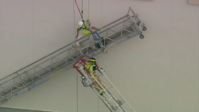 Construction worker rescued after scaffold gives way