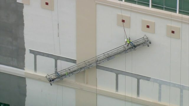 Worker rescued from slanted scaffold