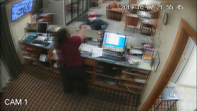 Hotel clerk grabs robber's gun, turns the tables