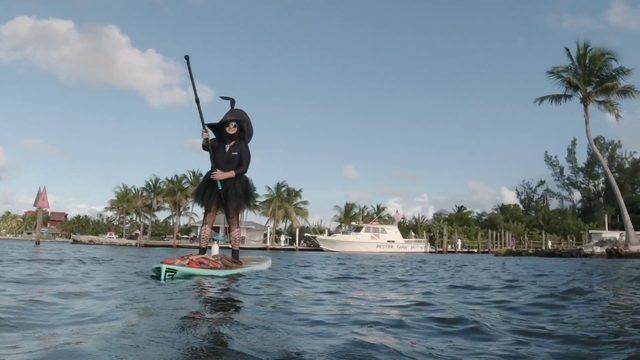 Ditch the brooms, Florida Keys witches celebrate full moon on paddleboards