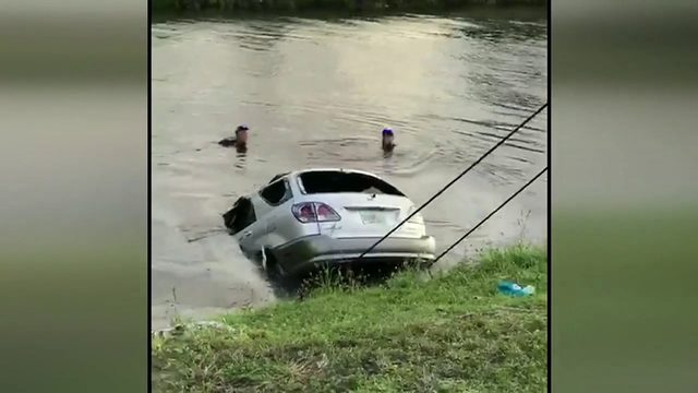 Woman rescued from submerged SUV that crashed into Miami Gardens canal