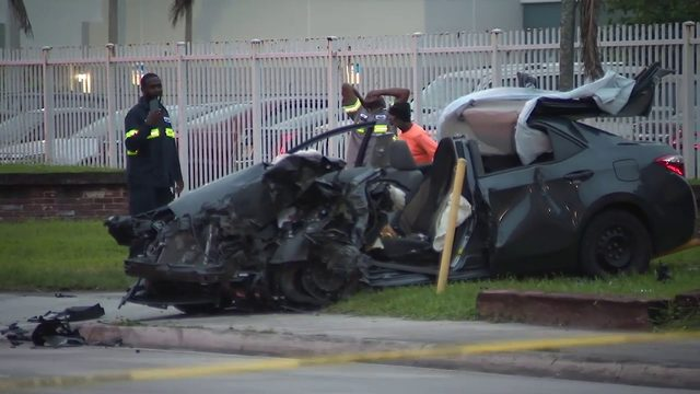 Car destroyed after slamming into garbage truck in northwest Miami-Dade
