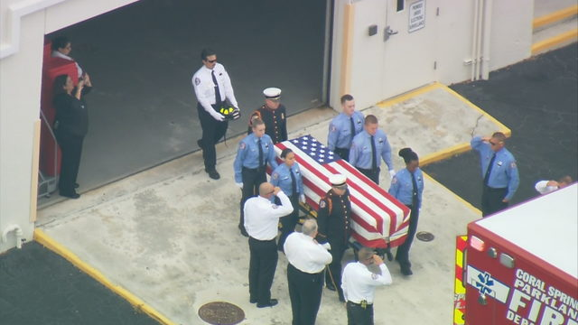Coral Springs firefighter honored as body leaves medical examiner's office