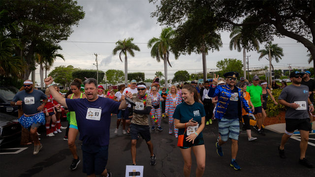 Doughnuts, beer stations offer runners relief