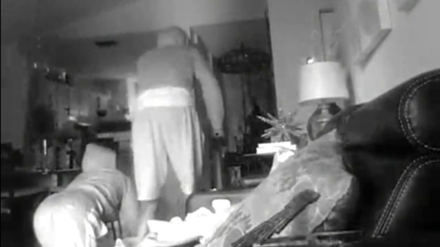 Surveillance video captures burglar crawling on floor of Tamarac home