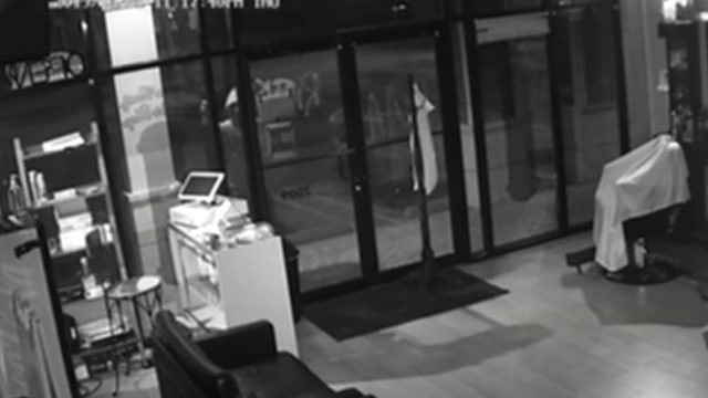 Vandal caught on camera targeting barber shop