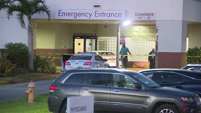 Officers investigate ER entrance in Miami shooting