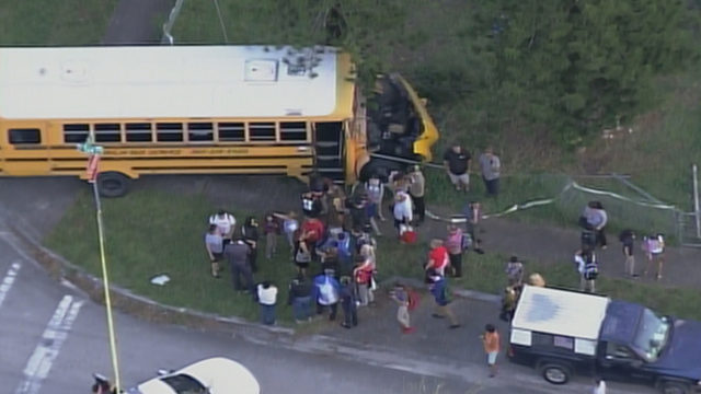 Woman ejected from vehicle following crash with Hialeah school bus