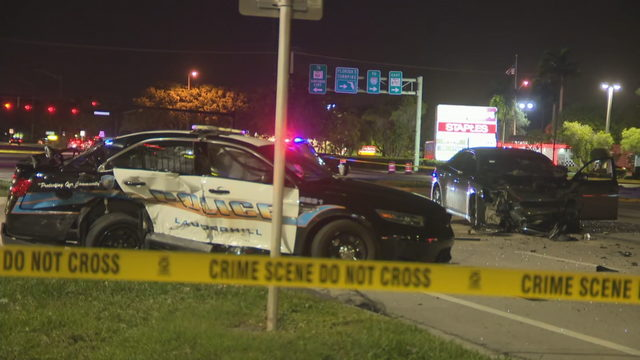Lauderhill police officer hospitalized, hit by car while sitting in her cruiser
