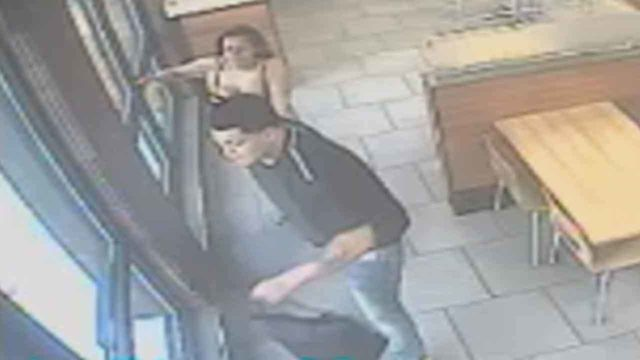Surveillance video shows man pulling woman out of Wendy's