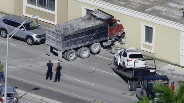 Dump truck crashes into building in southwest Miami-Dade