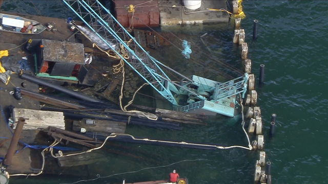 Construction barge, crane near Rickenbacker Causeway sinking