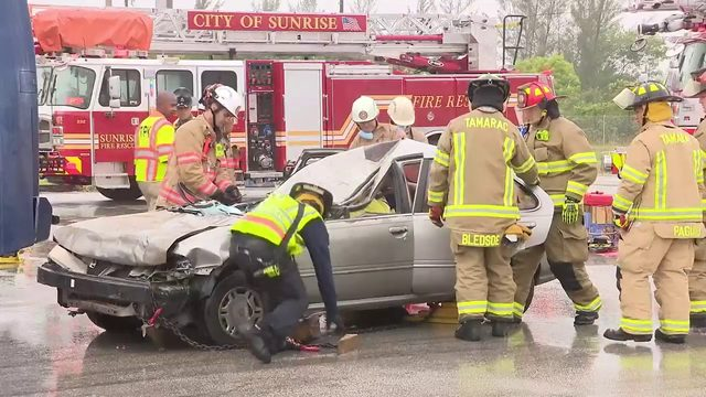 First responders educating community on move-over law using staged…