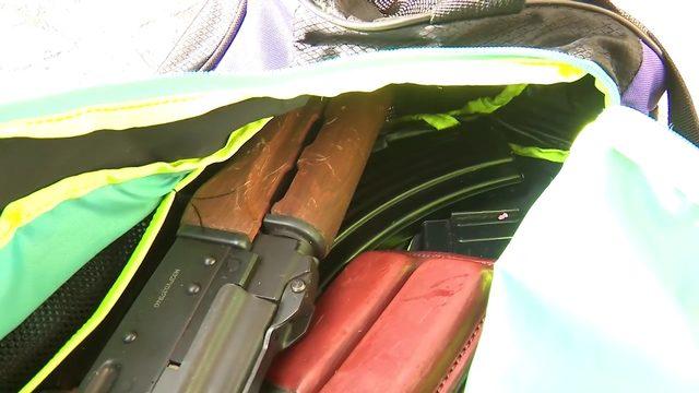 Gun, magazines found in duffel box in donation drop box