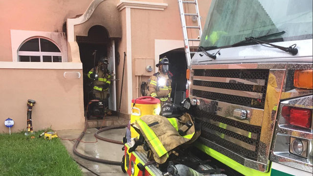 Miami-Dade firefighters respond to house on fire