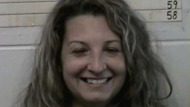 Woman smiles wide after arrest for husband's murder